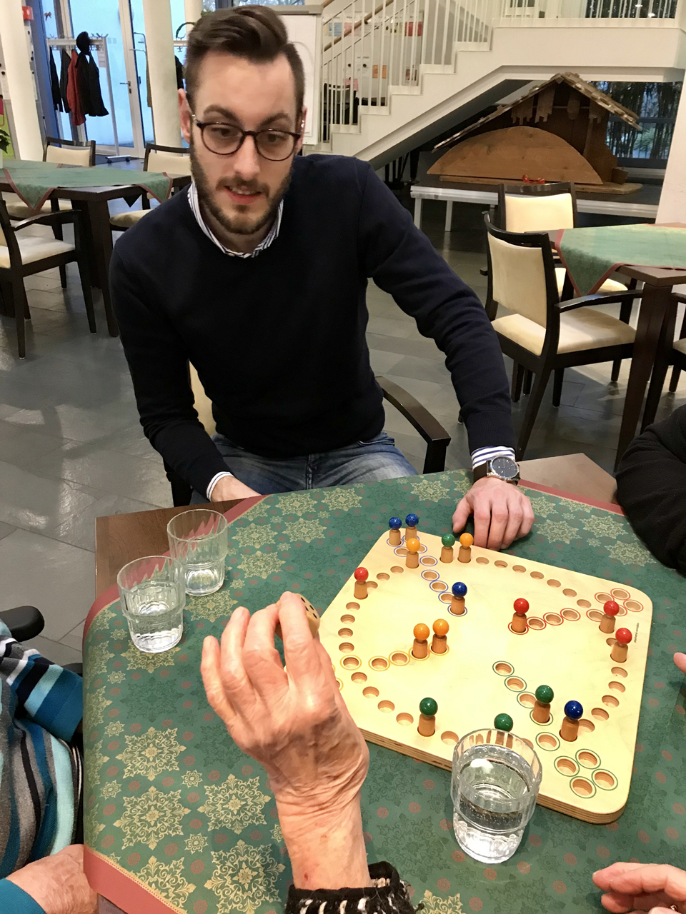Board game afternoon at a Frankfurt retirement center - a part of our social engagements.