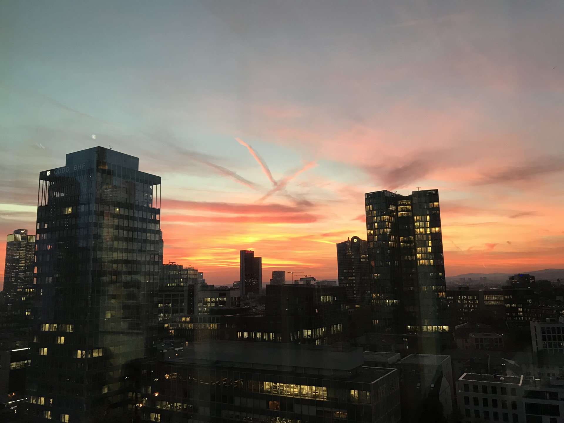 Above the roofs of Frankfurt - romantic evening atmosphere at our Frankfurt location.